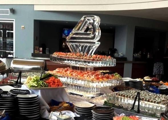 [Image: Bergstrom Automotive featured this seafood/sushi station from the help of High Cliff Catering and Krystal Kleer Ice Sculptures, LLC. ]