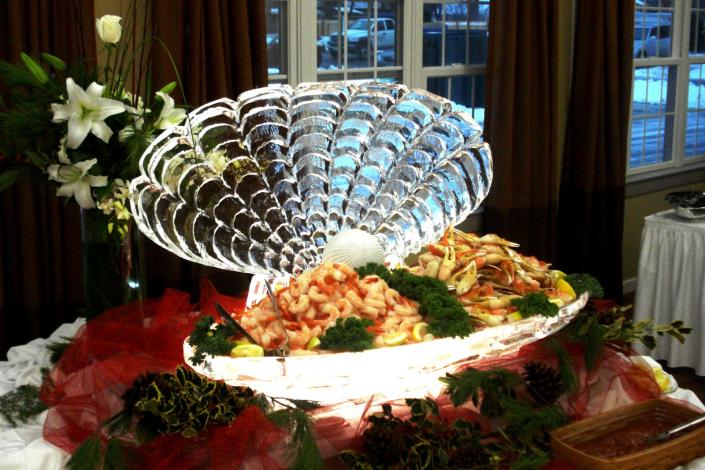This is an example of a function ice sculpture used as a seafood display. Keep your food cold and draw attention with a custom ice sculpture from Krystal Kleer Ice Sculptures, LLC. Functional Display work beautifully for seafood, fruit and/or vegetables at any corporate or private event!