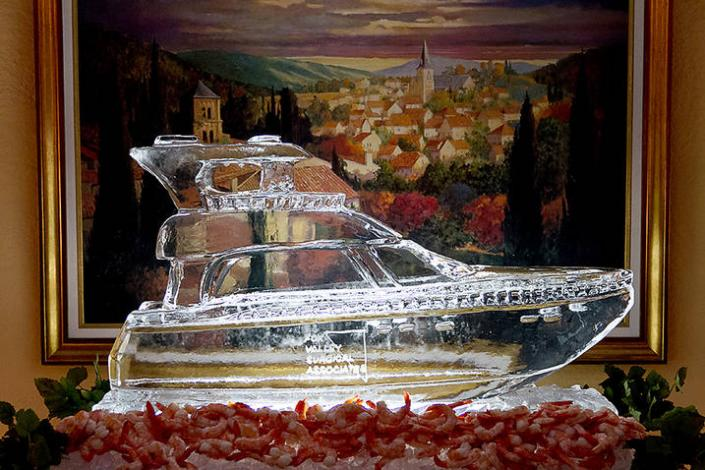 Adding a custom ice sculpture to your event is a great way to add elegant detail and really enhance your brand image. Feature your logo or a locally trademark near the food table to have them coming back for more. This piece was a custom Yacht for a retirement party.