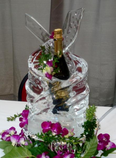 [Image: Keep your favorite drink cold with a one of a kind drink holder built from ice. Krystal Kleer Ice Sculptures can incorporate your favorite flowers, wedding colors, and more to match your event theme. ]