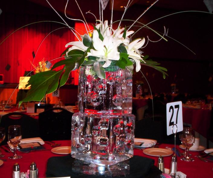 [Image: Looking for unique ways to add decor to your table centerpieces? Our ice centerpieces are one our customer's favorites! Feature your favorite fresh or artificial flowers with a custom mini centerpiece. Let the experts from Krystal Kleer Ice Sculptures, LLC help you wow your guest.  ]
