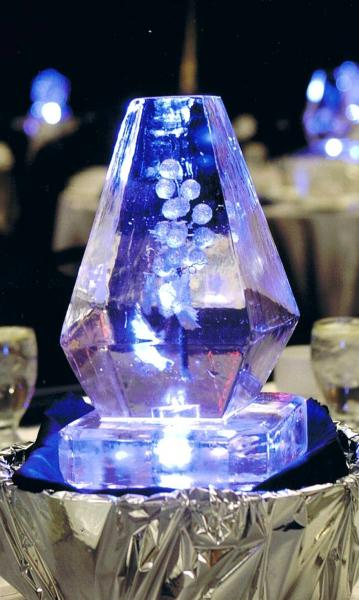 Krystal Kleer Ice Sculptures, LLC can incorporate your favorite flowers, colors, and theme into unique mini centerpieces. Contact us today to learn more. ]