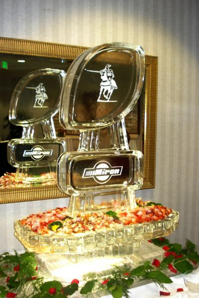 [Image: This seafood station was created For Miron. Contact us today to feature a functional ice sculpture at your next corporate event. ]