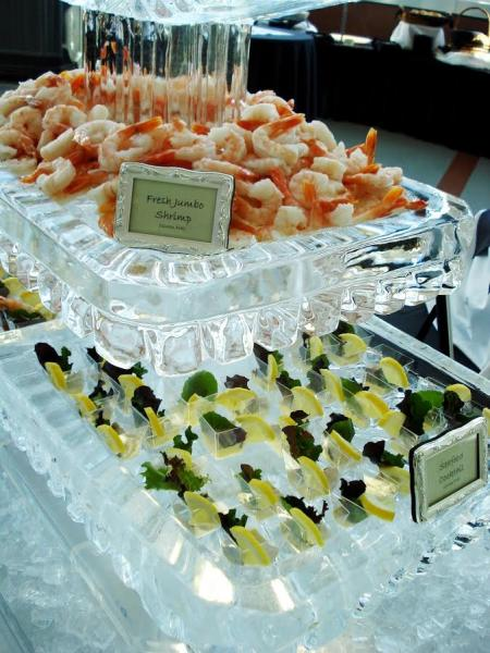 [Image: This custom shrimp display in the form of a functional food display was brought to you by Krystal Kleer Ice Sculptures, LLC. This Fried Jumbo Shrimp Display was a huge hit! Keep your food cold and your guest coming back for more. ]