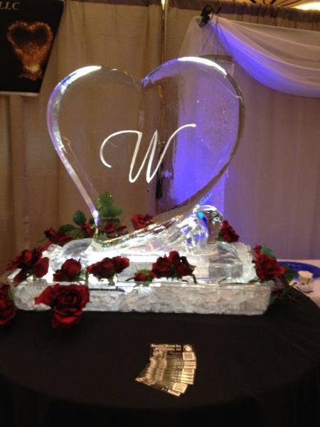 [Image: Monogram ice carvings can be as diverse as the people getting married, and can be functional or simply decorative. Please give us a call to learn more. We look forward to being a part of your next event. ]
